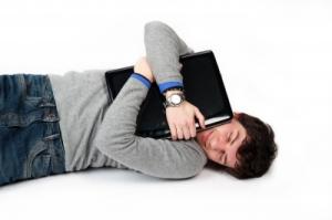 hugging laptop